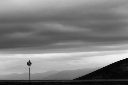 Road sign against a moody sky background with big clouds Reklamní fotografie