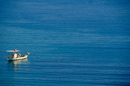 Small fishing boat in the Aegean sea, Greece.
