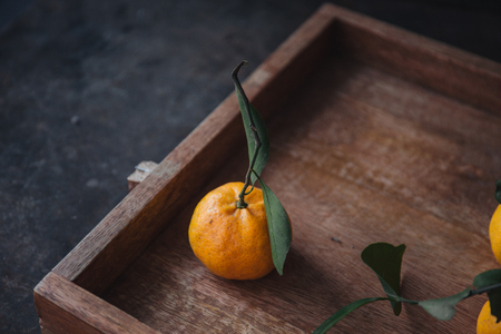 Mandarin orange on rustic background Stock Photo