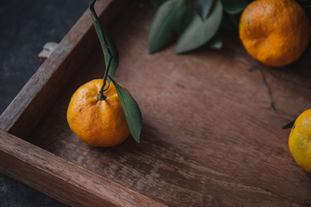 Mandarin orange on rustic background