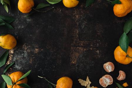 Mandarin orange on rustic background Stock fotó