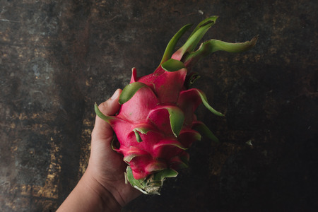 Dragon fruit on rustic background