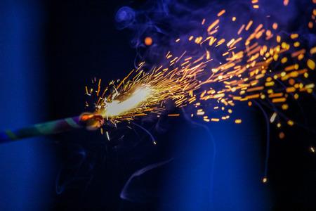 Sparklers in bluish background Stock Photo