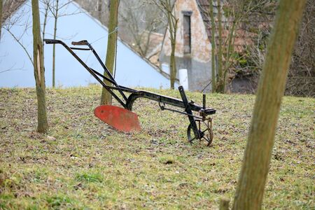 Agricultural old manual plow on grass.