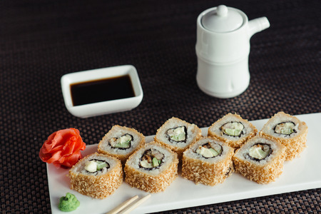 Japanese sushi on a white plate in restaurant