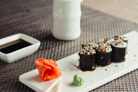 Traditional fresh japanese sushi rolls on a white plate