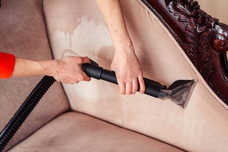 Sofa chemical cleaning with professionally extraction method. Upholstered furniture. Early spring cleaning or regular clean up in home. Foto de archivo