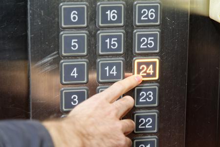 twenty: 24 twenty four floor elevator button with light and pushing finger