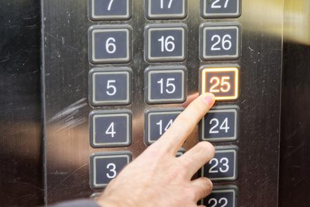 twenty five: 25 twenty five floor elevator button with light and pushing finger