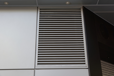 louver: ventilation grille on the wall of a building Stock Photo