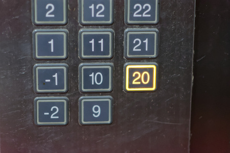 chrome man: Elevator button with number 20 pushed
