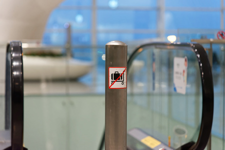 luggage carrier: No trolley sign in airport