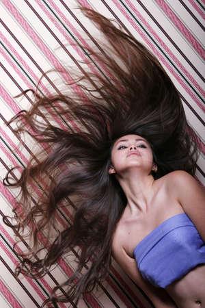 Pretty woman flipping her long hair
