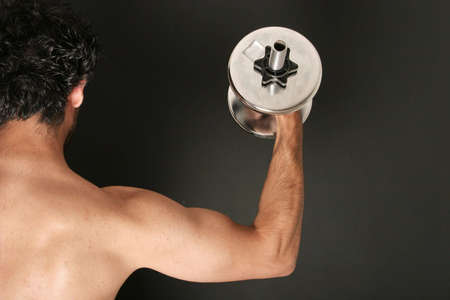 Athletic man working out with dumbbell Stock Photo - 697160
