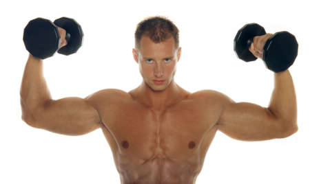 Athletic sexy man lifting dumbbells photo