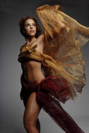 Sexy woman in silk Stock Photo