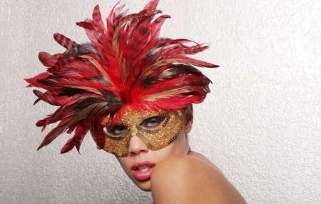 Beautiful biracial woman in mask photo