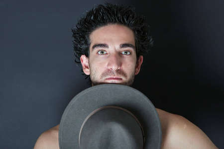 courteous: Handsome young man with cowboy hat