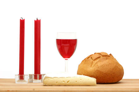 Red wine, bread, cheese and candles on white background Stock Photo - 1105975