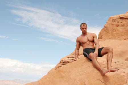 Sexy muscular man on red rocks Stock Photo - 1106031