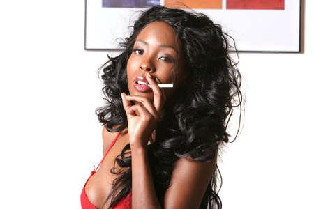 Beautiful sexy black woman smoking Stock Photo - 1140548