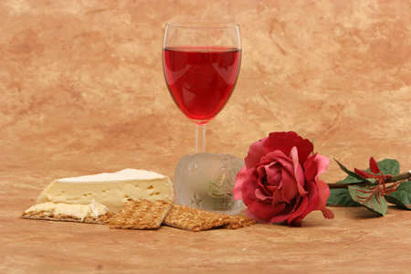 Red wine, crackers, cheese, rose and candles Stock Photo - 1140581