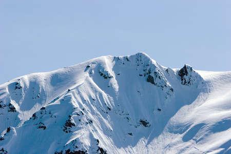 Snowy mountain tops in Alaska photo