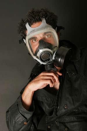 Man with a gas mask Standard-Bild