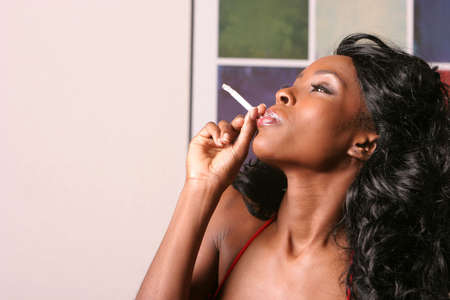 Beautiful sexy black woman smoking a cigarette Stock Photo - 1150137