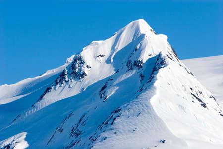alaska scenic: Snowy mountain tops in Alaska Stock Photo