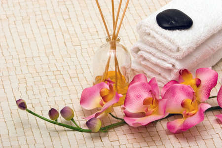 Spa towels, fragrance sticks and pink orchid photo