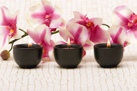 Aromatherapy candles and pink orchid photo