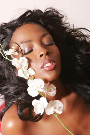 Black woman with orchid photo