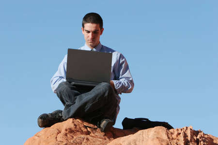 Young businessman working on his laptop Stock Photo - 1171670