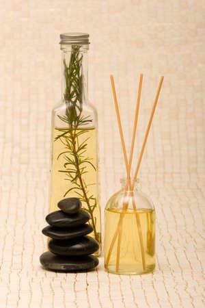 Massage oil, stones and fragrance sticks