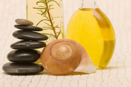 Essential oils and massage stones photo