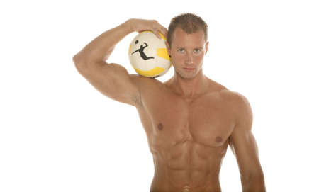 defined: Athletic man holding a ball Stock Photo