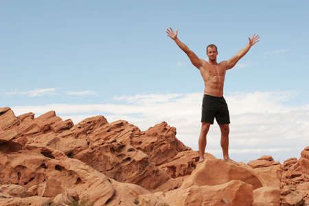 Sexy muscular man on red rocks Stock Photo - 1171734