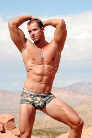 military training: Sexy muscular body builder Stock Photo