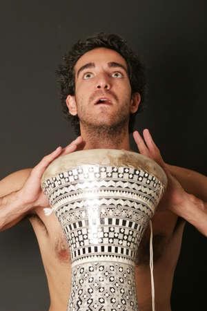 Handsome sexy drum player photo
