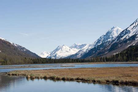 alaska scenic: Snow melting on mountains in Alaska