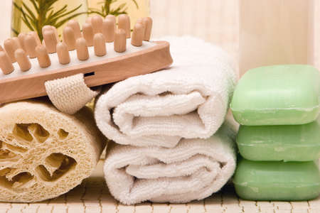 revitalize: Spa towels, soaps, loofah and massager Stock Photo