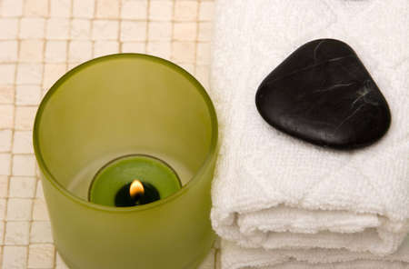 Spa towels, stones and candle