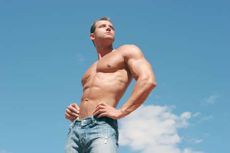 washboard: Sexy muscular body builder in jeans