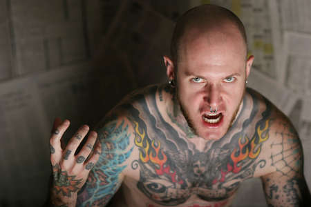 nosering: Angry tattooed man shouting