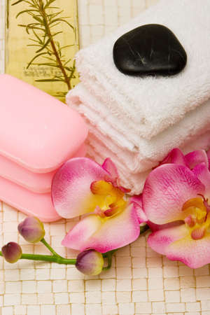 Spa towels, pink orchid and soaps photo