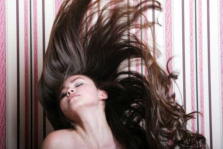Beautiful asian woman throwing her hair back photo