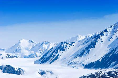 Snow covered beautiful mountain peaks photo