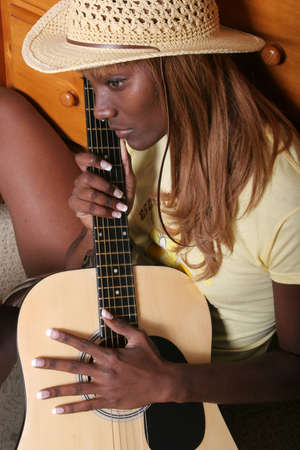 tune: African American musician with her guitar