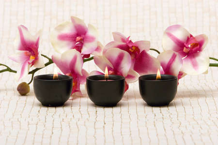 Aromatherapy candles and pink orchid Stock Photo - 1464500